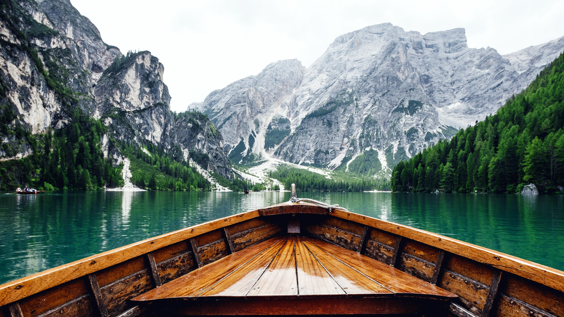 Boat on Lago di Braies. Virtual background to use on Zoom, Microsoft Teams, Skype, Google Meet, WebEx or any other compatible app.