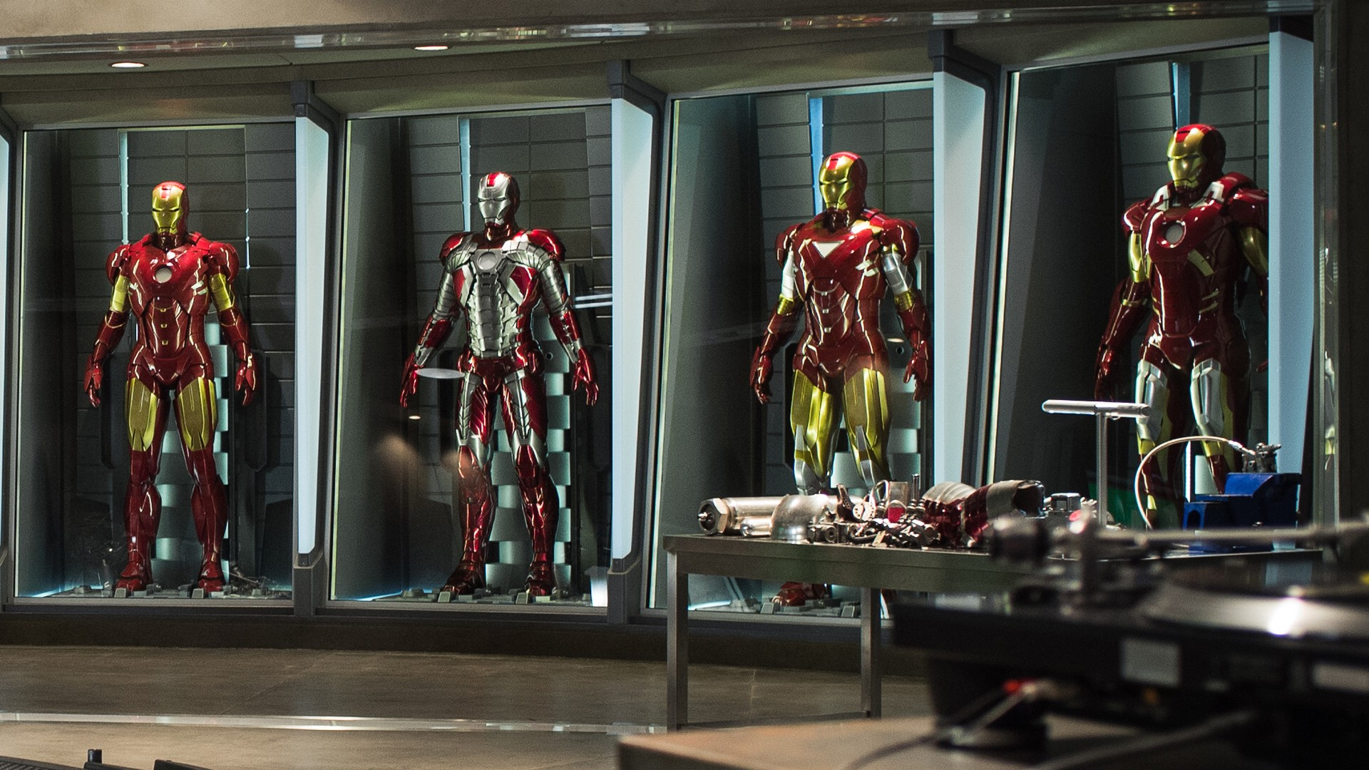 Iron Man suits on Tony Stark's lab. Virtual background to use on Zoom, Microsoft Teams, Skype, Google Meet, WebEx or any other compatible app.