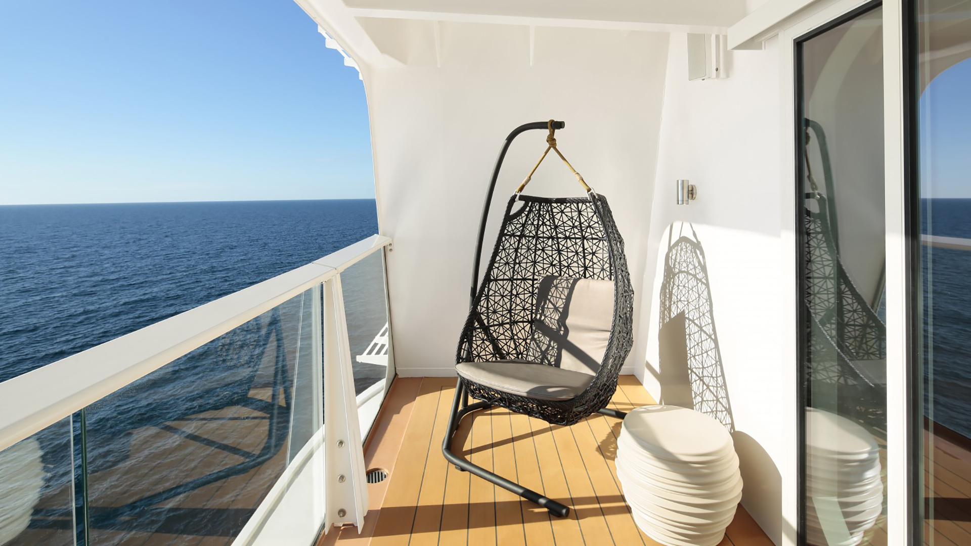 Hanging chair on a cruise balcony. Virtual background to use on Zoom, Microsoft Teams, Skype, Google Meet, WebEx or any other compatible app.