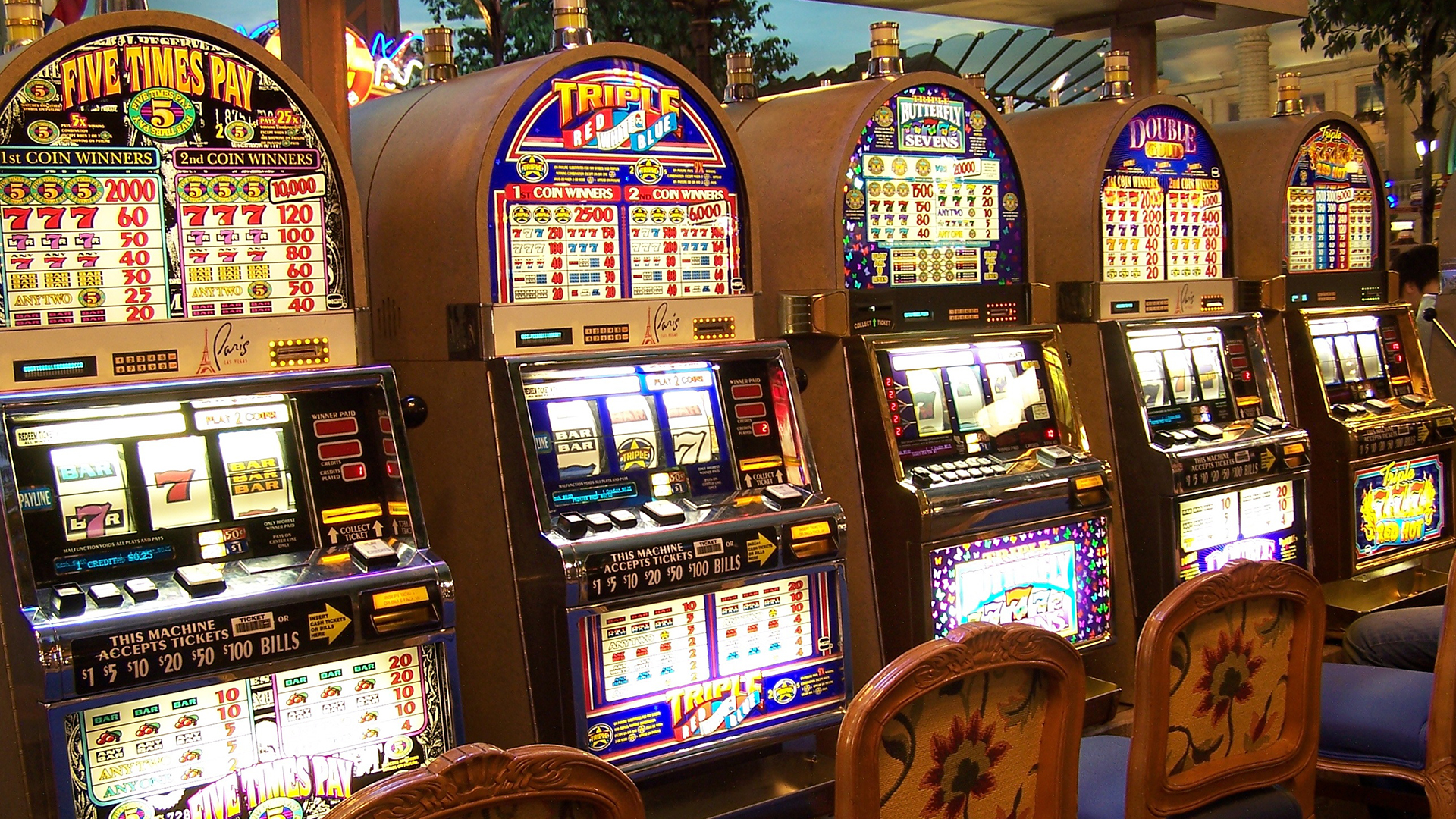 Slot machines in a casino. Virtual background to use on Zoom, Microsoft Teams, Skype, Google Meet, WebEx or any other compatible app.
