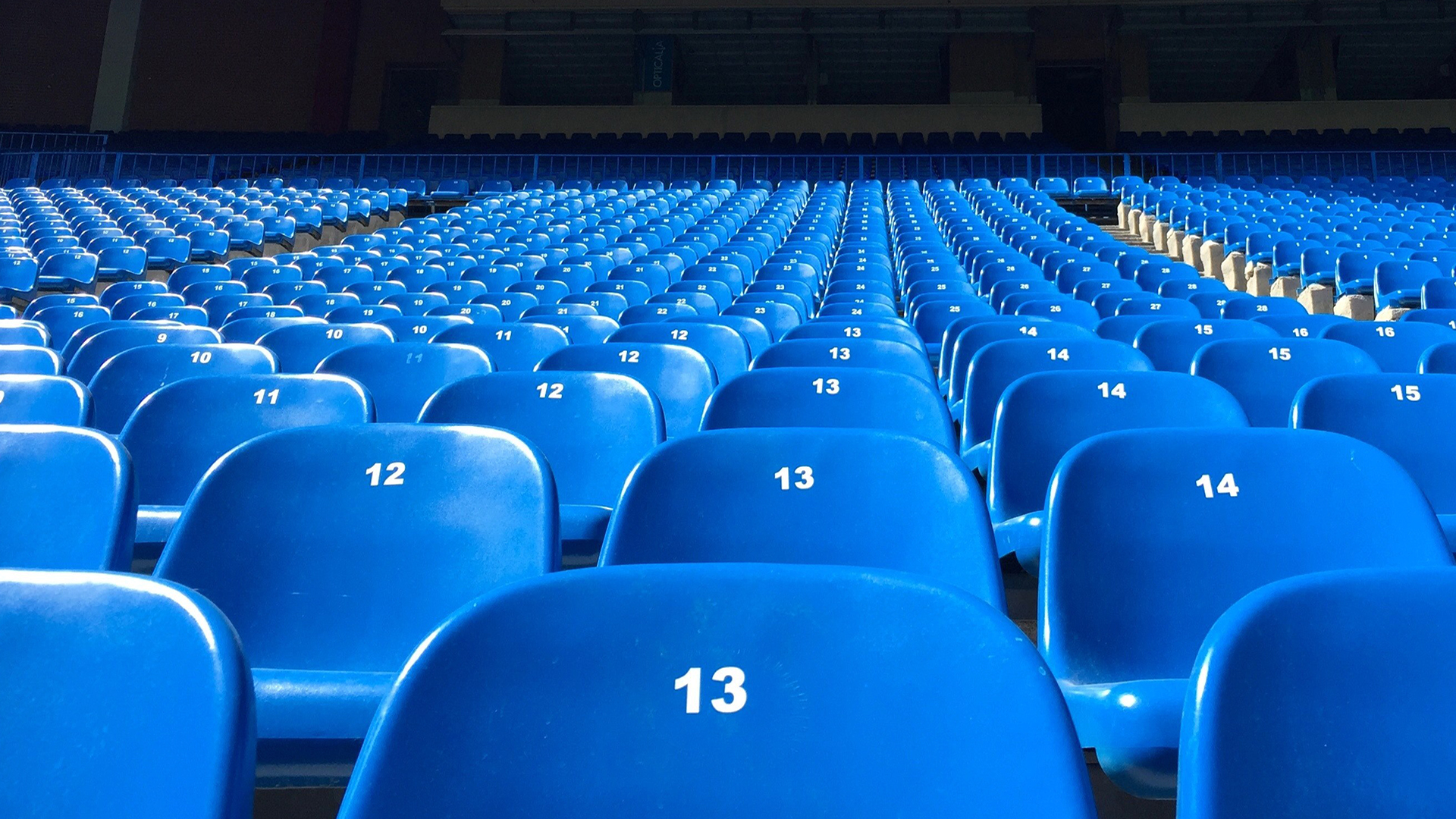 Blue seats in a stadium. Virtual background to use on Zoom, Microsoft Teams, Skype, Google Meet, WebEx or any other compatible app.