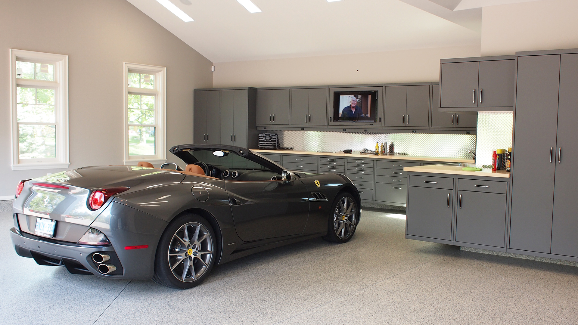 Garage with a Ferrari California. Virtual background to use on Zoom, Microsoft Teams, Skype, Google Meet, WebEx or any other compatible app.
