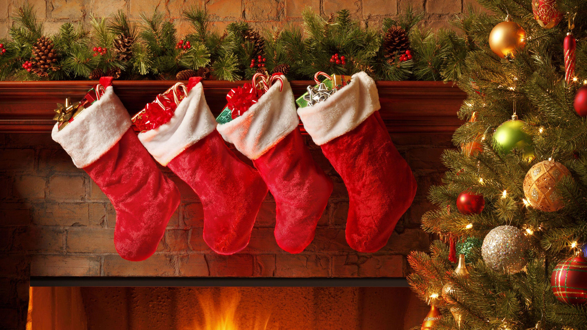 Christmas stockings on a fireplace. Virtual background to use on Zoom, Microsoft Teams, Skype, Google Meet, WebEx or any other compatible app.