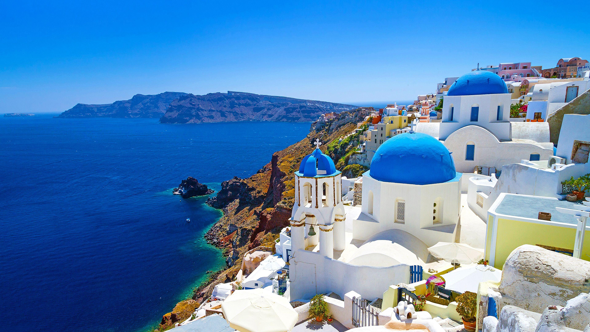 View of Santorini. Virtual background to use on Zoom, Microsoft Teams, Skype, Google Meet, WebEx or any other compatible app.